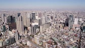 government district : Japan Tokyo Aerial v91 Flying near Shinjuku panning with cityscape views