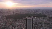 government district : Japan Tokyo Aerial v114 Flying over Shinjuku area with cityscape views at sunriseÊ