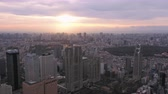 government district : Japan Tokyo Aerial v115 Flying over Shinjuku area with cityscape views at sunriseÊ