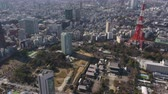 minato : Japan Tokyo Aerial v124 Birdseye view flying low over Minato area towards Tokyo tower Stock Footage