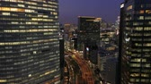 minato : Japan Tokyo Aerial v146 Flying low over Hamarikyu park with Ginza cityscape views dusk 217