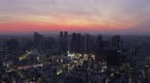 Japan Tokyo Aerial v163 Flying over Shinjuku area panning cityscape views dusk 217