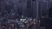 Japan Tokyo Aerial v160 Shinjuku birdseye view flying panning up to downtown cityscape dusk 217