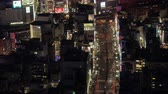 Japan Tokyo Aerial v165 Birdseye view flying low over famous Shinjuku area night 217 Stock Footage