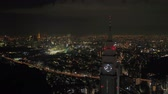 Japan Tokyo Aerial v170 Flying low around clock tower with cityscape views at night