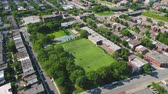 bairro : Montreal Quebec Aerial v84 Flying low around park field in neighborhood