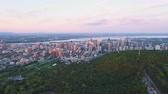 Montreal Quebec Aerial v90 Flying over Mount Royal park panning at sunset with cityscape views