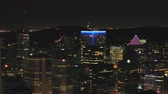 Montreal Quebec Aerial v116 Flying low across downtown at night with cityscape views 717