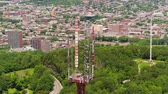 temető : Montreal Quebec Aerial v120 Closeup flying around radio tower with cityscape and park views