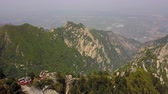 mavic : China Mt Huashan Aerial v7 Flying over mountain climbing path and ridges 517 Stock Footage