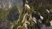 mavic : China Mt Huashan Aerial v8 Flying over mountain climbing path and ridges 517 Stock Footage