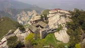 birdseye : China Mt Huashan Aerial v11 Flying along mountain climbing path and peak 517