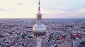mavic : Germany Berlin Aerial v29 Flying low around Berliner Fernsehturm tower cityscape views sunset 817 Stock Footage