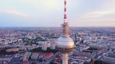 mavic : Germany Berlin Aerial v31 Flying low around Berliner Fernsehturm tower cityscape views sunset 817 Stock Footage