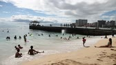waikiki : Waikiki, Oahu, HI - August 27, 2016: children play in the crowded Kuhio Beach called The Ponds because a concrete wall makes calm water and safe. Kuhio Beach is great for boogie boarding.