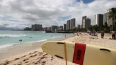 waikiki : Waikiki ,Oahu, HI - August 27, 2016: serf rescue in San Souci Beach. San Souci Beach is it off the Waikiki hotel strip and is a haven for swimmers, kayakers and surfers. On background Waikiki Skyline. Stock Footage