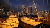 catamaran : Waikiki, Oahu, Hawaii - August 20, 2016:panorama of sailing boats docked at the Ala Wai Harbor the largest yacht harbor of Hawaii and Honolulu skyline at sunset. On background luxurious city hotels.