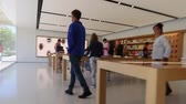 pracoviště : Cupertino, CA, USA - August 15, 2016: people inside the Apple store of Apple Inc HQ at One Infinite Loop. Apple is a multinational corporation that produces consumer electronics, computers, software.