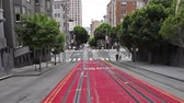 yolcu : San Francisco, California, United States - August 17, 2016: Cable Car, Powell-Manson lines, of San Francisco, riding up the uphill of Powell Street, higher and higher. Stok Video