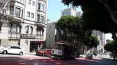kablolar : San Francisco, California, United States - August 17, 2016: The popular Cable Car of San Francisco, Powell-Hyde lines, full of tourists along the famous Powell Street on the uphill