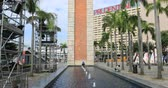 hk : Hong Kong, China - December 5, 2016: Tilt view of Clock Tower with a pool at Tsim Sha Tsui. The landmark 44 meter tower is the only remain of the original Kowloon Station on the Kowloon-Canton Railway