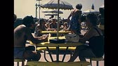 70年代 : Jones Beach, United States of America - circa 1970: tourist people on holiday in the beach bar drinking in 70s. Vintage footage. 動画素材