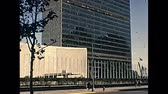 estados unidos : New York, United States of America - circa 1970: street view old footage of United Nations headquarter from United Nations plaza square. with people and bus.