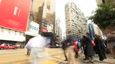 yee : Hong Kong, China - December 6, 2016: A huge crowd crossing at Yee Wo Street junction with Hennessy Road, Causeway Bay, luxury shopping district, one of the busiest junctions in Hong Kong. Time lapse.