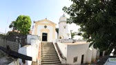 capela : Macau, China - December 9, 2016: Fish-eye time lapse of facade Guia Lighthouse, Fortress and Chapel in Historic Centre of Macau, China. Sunny day, blue sky. Front view.