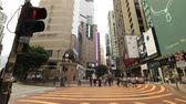 типичный : Hong Kong, China - December 6, 2016: Time lapse of typical busy asian people with fashion dress, walking fast in Times Square, Causeway Bay, looking for shopping.