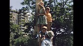 baleares : MAJORCA, SPAIN - 1970: tourist family in typical 70s clothes, visiting Palma de Mallorca square. Majorca capital and largest city of Balearic Islands. Historical footage.