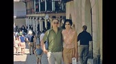 baleares : MAJORCA, SPAIN - 1970: tourist couple in typical 70s clothes, visiting Palma de Mallorca streets. Majorca capital and largest city of Balearic Islands. Historical footage. Stock Footage