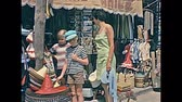 baleár : MAJORCA, SPAIN - 1970: tourist family in vintage dresses, shopping for souvenirs and pearls necklaces in Palma de Mallorca. Majorca capital and largest city of Balearic Islands. Historical footage