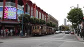 jones : San Francisco, California, United States - August 14, 2016: panoramic view of Fishermans Wharf crossroad waterfront of SF. Applebees corner restaurant and wheel cable car stop OFarrell Jones Hyde.