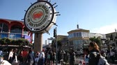 sf : San Francisco, California, United States - August 14, 2016: Fishermans Wharf waterfront crossroad of San Francisco on Jefferson road. Street rapper singer and tourists on the road.