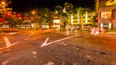 waikiki : HONOLULU, OAHU, HAWAII, USA - AUGUST 21, 2016: Time lapse at night of a Waikiki crossroad. People moving for shopping and car crossing. Cityscape night lights. Luxury, holidays and nightlife concept.