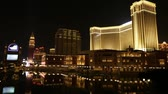 las vegas strip : Macau, China - December 8, 2016: Facade, bridge and gondolas of The Venetian, largest casino in world and largest single structure hotel building in Asia, reflecting in the lake at night.