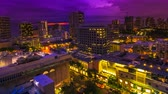 waikiki : Moving time lapse of changing pink light at twilight of Waikiki cityscape in Oahu, Hawaii, United States. Sun setting to dark sky with moving clouds and stars. City night lights and nightlife concept. Stock Footage