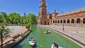 plaza de espana : Seville, Andalusia, Spain - April 18, 2016: Plaza de Espana square, panoramic view from the bridge. River with moving boats and people in the day time