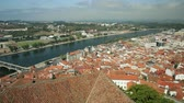 university : Coimbra panoramic view from bell clock tower. Coimbra skyline on Mondego river. Coimbra in Central Portugal, is famous for its University. Stock Footage