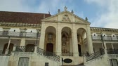 university : Coimbra, Portugal - August 14, 2017: Coimbra University of Portugal, the most ancient of the country and also one of the oldest in Europe. Main Building in the Paco das Escolas and iconic Clock Tower.