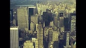 терраса : Archival Manhattan skyline aerial view from the top of Empire State Building. Old streets of old New York city, United States of America in 1981. Archival USA on 80s with bridges and skyscrapers. Стоковые видеозаписи