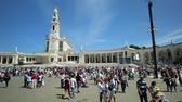 manevi : Fatima, Portugal - August 15, 2017: Square of Sanctuary of Our Lady of Fatima with people, one of the most important Marian Shrines and pilgrimage locations for Catholics. Basilica of Nossa Senhora. Stok Video