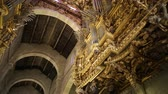 резной : Braga, Portugal - August 12, 2017: beautilful organ and ceiling of main nave in carved wood of Braga Cathedral in Baroque style. Se de Braga is the oldest cathedral in Portugal, Europe.