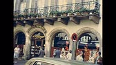 petite france : STRASBOURG, FRANCE - CIRCA 1970: Historical downtown old shopping streets of Strasbourg with vintage cars. 1970s Ancient Rue Merciere road in 1970s, with old fashion dressed people.