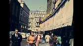 petite france : STRASBOURG, FRANCE - CIRCA 1970: Historical downtown old shopping roads of Strasbourg in 1970s along the ancient Rue des Grandes Arcades, with old fashion dressed people.