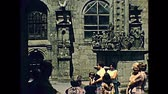 vezetett : Saint-Thegonnec, Morlaix, Brittany, FRANCE - July 15, 1976: tourists in vintage dress on a guided tour of the Notre-Dame church at Saint-Thegonnec parish in 1970s. Restored archival from 70s in France