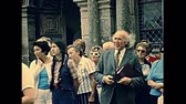 vezetett : Saint-Thegonnec, Morlaix, Brittany, FRANCE - July 15, 1976: guided tour in Notre-Dame church at Saint-Thegonnec parish. Restored archival from 70s in France.