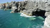 sea caves : Hells Mouth, Atlantic coast of Cascais, Portugal. Boca do Inferno, a natural arch in rough cliff formation.Tourism and travel concept in Portugal
