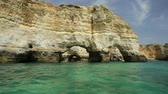 sea caves : Natural arch Elephant Rock of Praia da Marinha in Algarve, Portugal, Europe view from popular boat cave tour along Algarve coast. Marinha Beach is one of the 100 most beautiful beaches in the world. Stock Footage